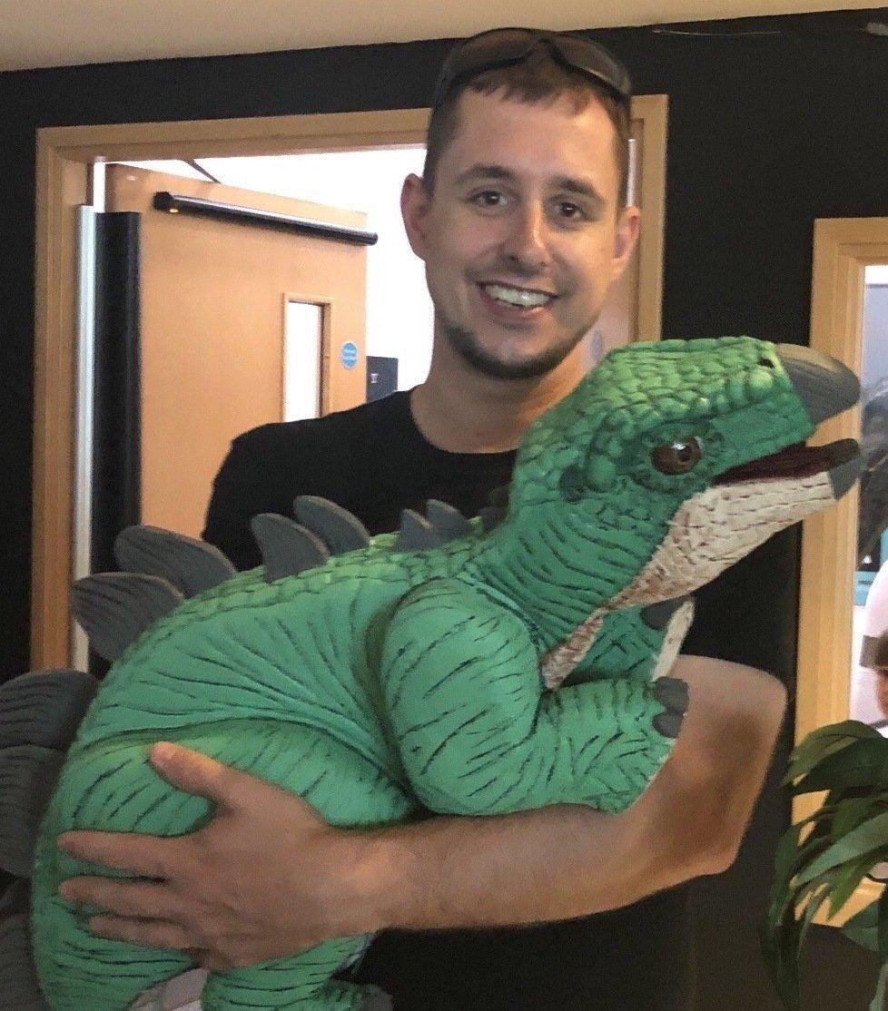 baby stegosaurus puppet being help